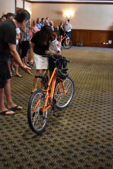 Kalos Financial Atlanta Kalos on a Mission 2019 Costa Rica child hug bike