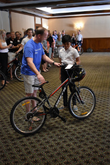Kalos Financial Atlanta Kalos on a Mission 2019 Costa Rica child receiving bicycle
