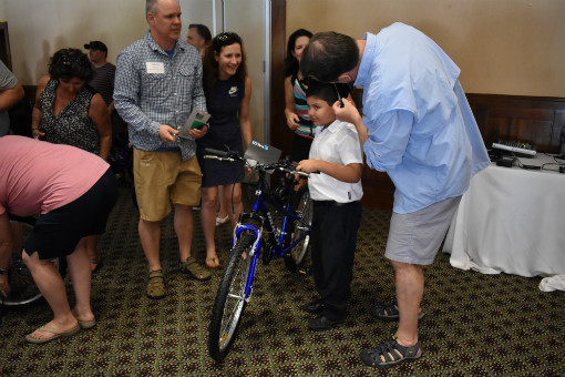 Kalos Financial Atlanta Kalos on a Mission 2019 Costa Rica child receiving bike