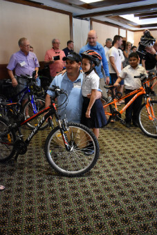 Kalos Financial Atlanta Kalos on a Mission 2019 Costa Rica girl receiving bike