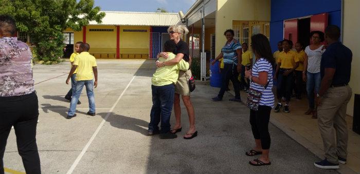 Kalos Financial Atlanta Kalos on a Mission Curacao 2016 student hug